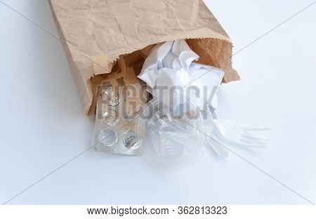 Brown Ecological Paper Bag With Plastic And Paper Rubbish Waste Inside. Isolated On White Background