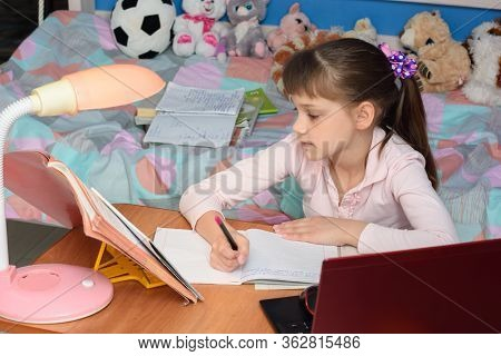 Girl At Home Doing A Home Work