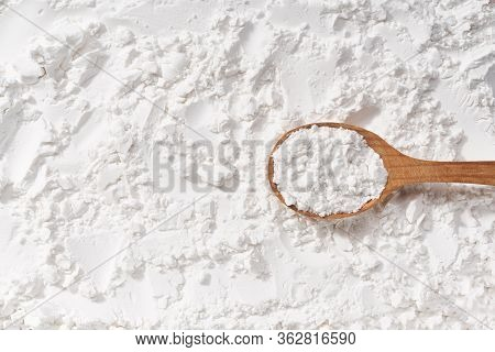 Background Of Corn Starch Flour Powder Texture Close-up. Top View.