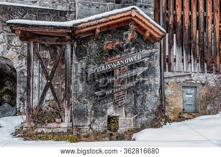 Feb 6, 2020 - Hallstatt, Austria: Wooden Guidepost Poiting Direction Covered With Snow In Hallstatt