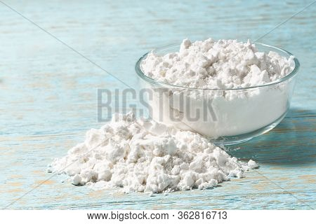 Glass Plate With Potato Starch On A Wooden Table.