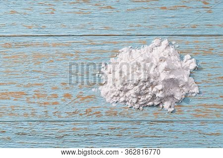 Pile Of Potato Starch On A Wooden Table. Top View.