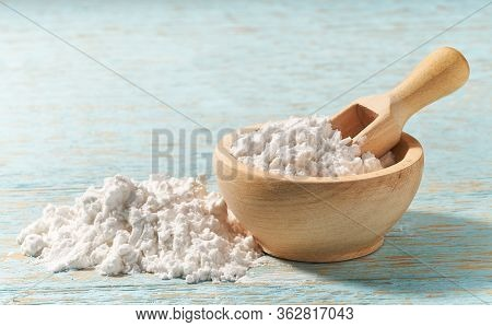 Little Wooden Bowl With Corn Starch On A Wooden Table, With Copy Space.