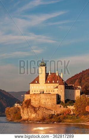 Small castle Schonbuhel above the Danube in the romantic sunset, Austria