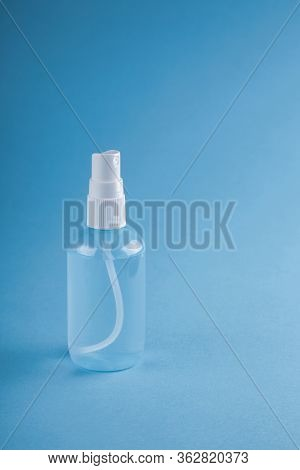 Bottle Of Antiseptic Gel Isolated On Blue. Antibacterial Spray For Hands Antiseptic Wet Wipes In Han