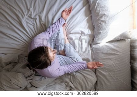 Young Beautiful Woman Doing Meditation On Bed
