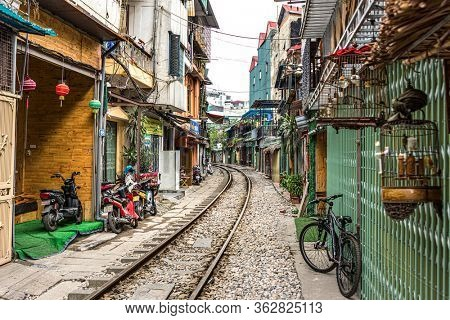 Hanoi, Vietnam, December 30, 2019 : Train Street in Hanoi. Attraction where tourists can watch a train speeding by along a cramped thoroughfare. Street has many shops and cafes.