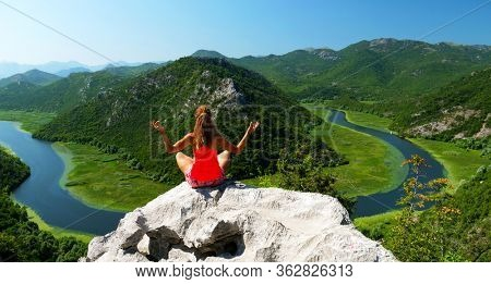 woman sitting on the rock- Lake Skadar in Montenegro
