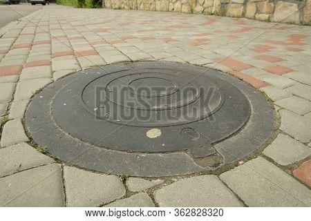 Installed Sewer Hatch On The Sidewalk, Metal Sewer Hatch