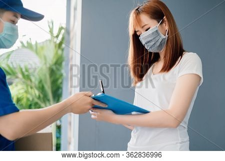 Door To Door Delivery Express Sending Send A Package Wearing Mask To Customer Receiver Sign Checking