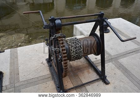 Metal Chain On Hand Crank Reel And Water