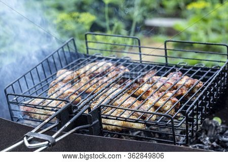 Process Cooking Meaty Steak On A Barbecue Grill Outdoors. Picnic, Eating Outdoors. Metal Barbecue Gr