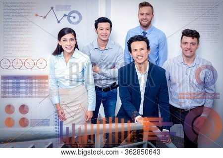 Team Standing On Office Stairway And Virtual Statistic Graphics. Five Smiling Middle-aged Business P