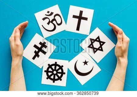 World Religions Concept. Hands Hugs Christianity, Catholicism, Buddhism, Judaism, Islam Symbols On B
