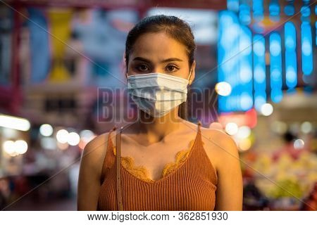 Face Of Young Asian Tourist Woman Wearing Mask For Protection From Corona Virus Outbreak In Chinatow