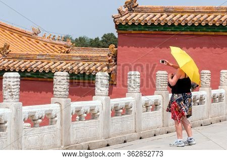 Beijing, China - May 24 2013: Tourist Takes A Photo In The Forbidden City Palace Complex. This Palac