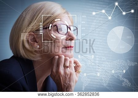 Pensive Senior Businesswoman And Virtual Identification Graphics. Closeup Portrait Of Attractive Sen