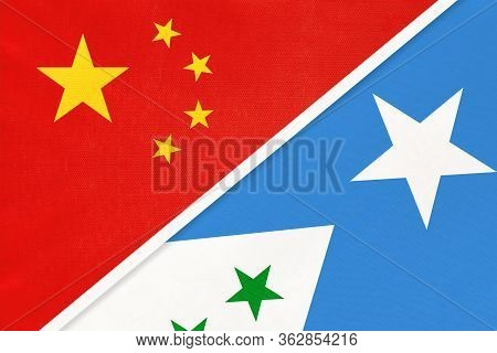China Or Prc Vs Galmudug National Flag From Textile. Relationship Between Asian And African Countrie