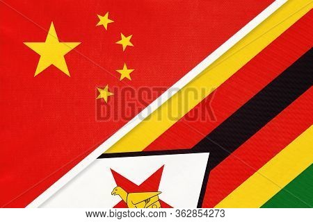 China Or Prc Vs Zimbabwe National Flag From Textile. Relationship Between Asian And African Countrie