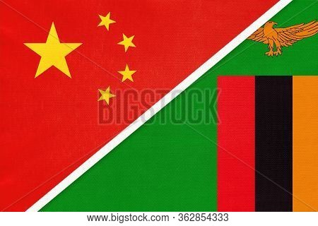 China Or Prc Vs Zambia National Flag From Textile. Relationship Between Asian And African Countries.