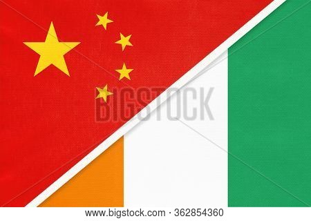 China Or Prc Vs Ivory Coast National Flag From Textile. Relationship Between Asian And African Count