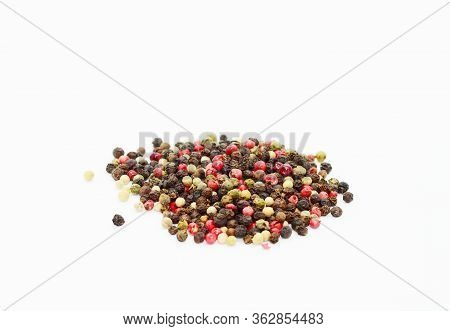Isolated Peppercorn Mix Of Black, White, Pink And Green Peppercorns On White Background.