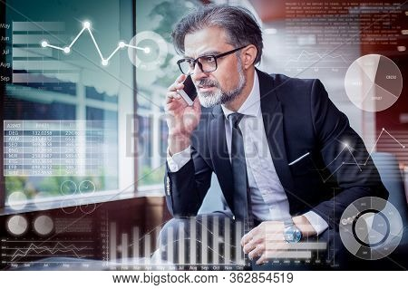 Tensed Man Talking On Phone And Virtual Statistic Graphics. Closeup Portrait Of Middle-aged Handsome