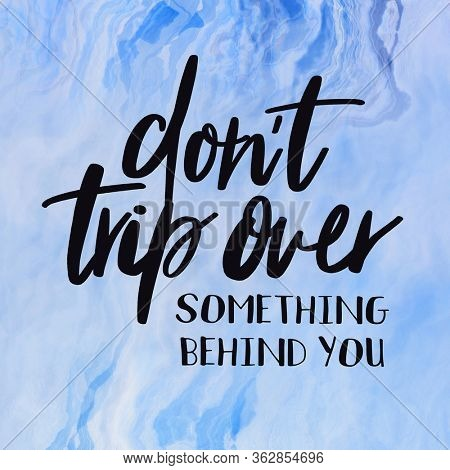 Quote on Blue background - Don't trip over something behind you