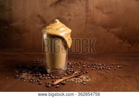 Cold Dalgon Coffee In Clear Glasses On A Dark Wooden Background. Foam From Sugar And Instant Coffee