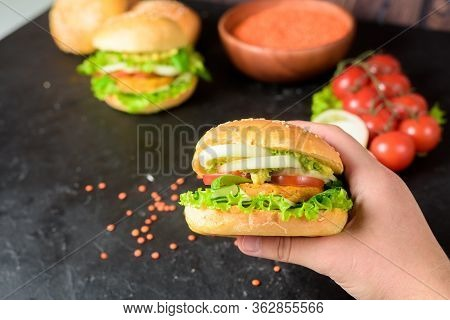 Vegan Burger With Lentil Cutlets . Vegan Food With Vegetable Protein, Herbs, Tomatoes, Onions On A D