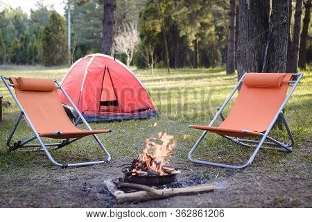 Camping In Nature. Happy People Lifestyle. Tent And Campfire In Nature. Nature Lifestyle Campfire. H