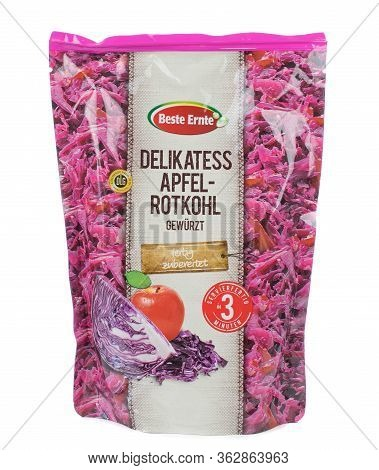 Niedersachsen, Germany April 23, 2020: A Bag Of Shredded Apple And Red Cabbage On A White Background