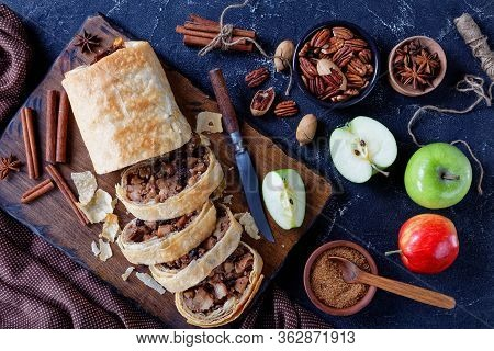 Traditional Austrian Apple Strudel Of Phyllo Dough With Sliced Caramelized Apples With Brown Sugar,