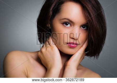 Closeup Portrait Of A Lovely Glamour Woman On Gray Background, Studio Shoot.