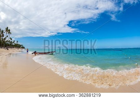 Punta Cana, Dominican Republic - March 11, 2020: Boat And Beautiful Sand Beach With Tourists In Punt