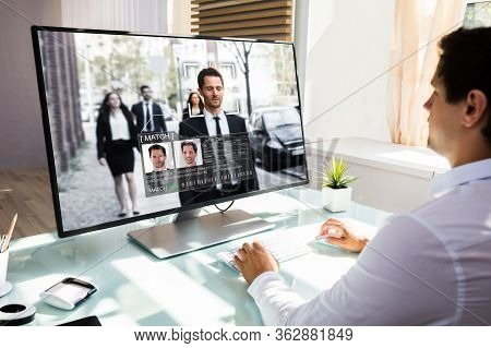 Cctv Operator Looking At Surveillance Footage Using Ai Face Recognition