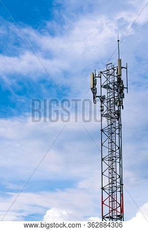 Telecommunication Tower With Clear Blue Sky Background. Antenna On Blue Sky. Radio And Satellite Pol