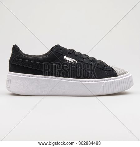 Vienna, Austria - January 12, 2018: Puma Suede Platform Glam Jr Black, Silver And White Sneaker On W