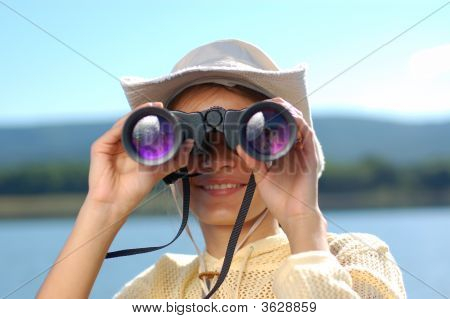 Woman With The Binoculars Over A Mountains  And Blue Sky