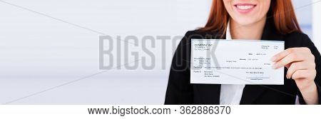Stimulus Check And Ppp Loan Paycheck. Women Holding Payroll Cheque