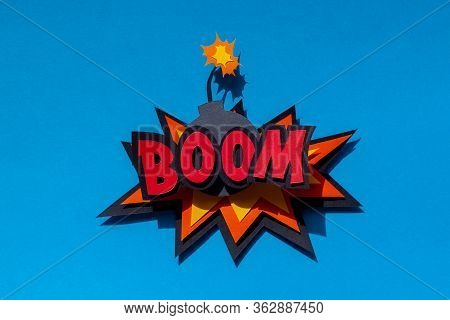 Handmade Paper Speech Bubble On Blue Background. Cartoon And Pop Art Style. Boom Text. Expression. B