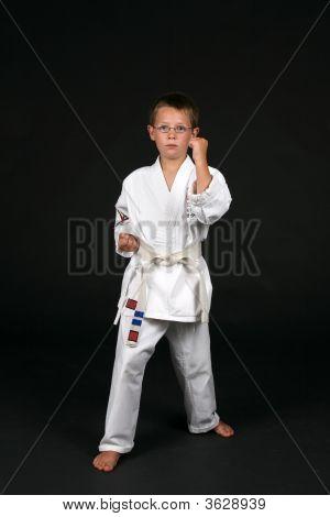 Traditional Karate Student Demonstrating Double Bone Block