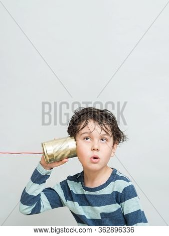 Little Boy Holding A Can With A Cord