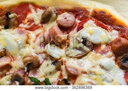 Slice Of Pizza With Sausage And Mushrooms Closeup