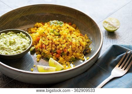 Indian Cuisine Indian Food. Indian Cuisine. Poha Or Flattened Rice Traditional Western Indian Breakf