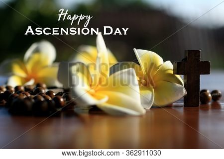 Happy Ascension Day Concept With Wooden Rosary Beads, Jesus Christ Holy Crucifix, Bali Frangipani Fl