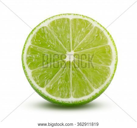 Juicy Slice Of Lime Isolated On White Background. Close Up Of Green Fresh Lime Fruit In Front Cut. S