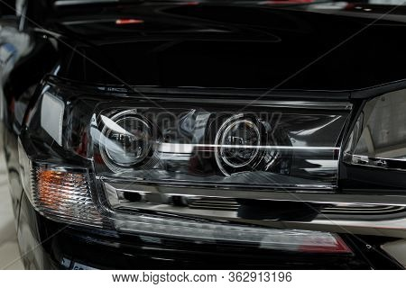 Headlight Of Modern Prestigious Black Car Close Up. Close Up Photo Of Modern Car, Detail Of Headligh