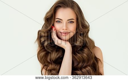 Beautiful Laughing Brunette Model  Girl  With Long Curly  Hair . Smiling  Woman Hairstyle Wavy Curls