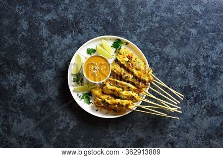 Grilled Chicken Skewers Served With Peanut Dipping Sauce. Chicken Satay With Peanut Sauce. Tasty Mea